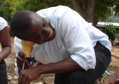 Using a listening stick in Ghana (courtesy Malcolm Farley)